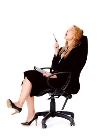 people sitting on chair: thoughtful businesswoman sitting in office chair has an idea