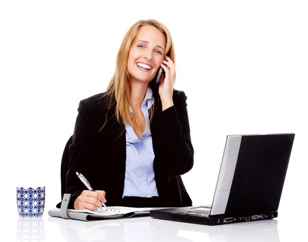 approachable: Business communication woman is working at her desk and talking on the phone