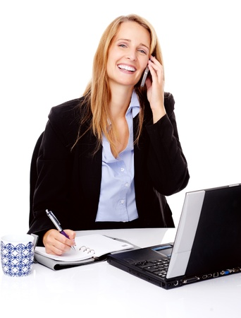 Business communication woman is working at her desk and talking on the phone photo