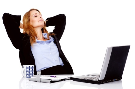 Business woman taking a break and relaxing with her hands behind her head and sitting on an office chair Stock Photo - 13025543