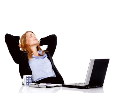 Business woman taking a break and relaxing with her hands behind her head and sitting on an office chair photo