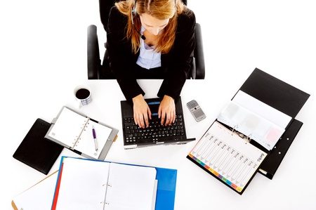 busy woman working at her desk. view from overhead of messy desk and multitasking women Stock Photo - 13025943