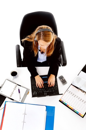 busy woman working at her desk. view from overhead of messy desk and multitasking women photo