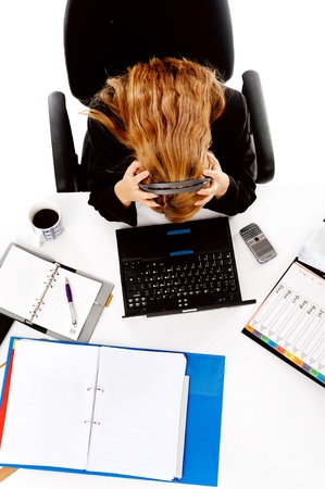 stressed business woman is overwhelmed by the workload and gives up Stock Photo - 13025964