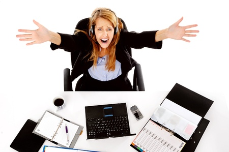 messy desk: stressed business woman is overwhelmed by the workload and gives up Stock Photo
