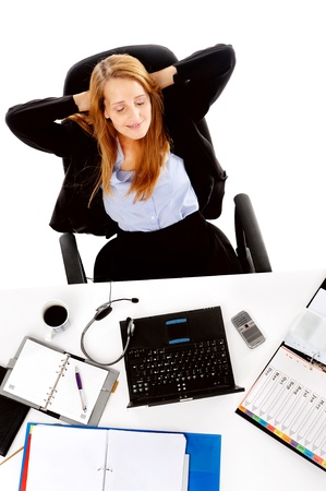 Business woman taking a break and relaxing with her hands behind her head and sitting on an office chair Stock Photo - 13025954