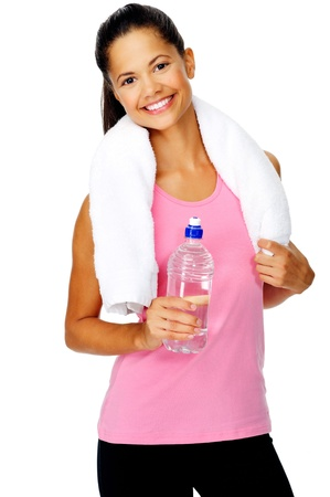 girl in towel: Healthy hispanic lation woman with gym towel and water bottle isolated on white
