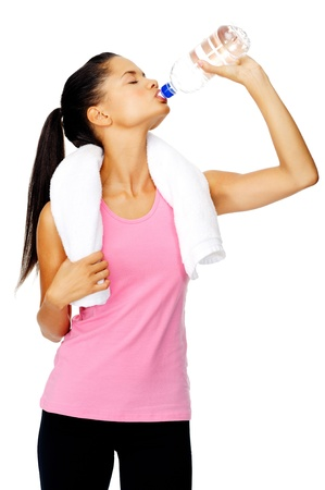 Healthy hispanic lation woman with gym towel drinking out of water bottle photo