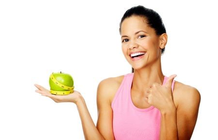 thumbs up woman: Healthy happy hispanic woman with apple and tape measure for diet and weight loss concept