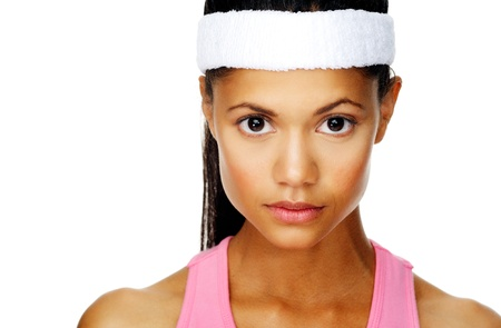 sport woman portrait with focussed determination expression and serious face photo