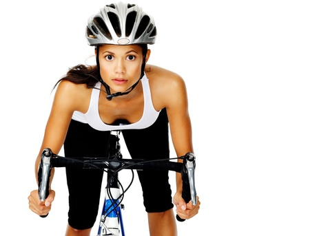 racing bike: Mixed race woman concentrates with a serious face, wearing a helmet on a bicycle Stock Photo