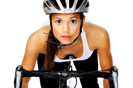 concentrates: Mixed race woman concentrates with a serious face, wearing a helmet on a bicycle Stock Photo