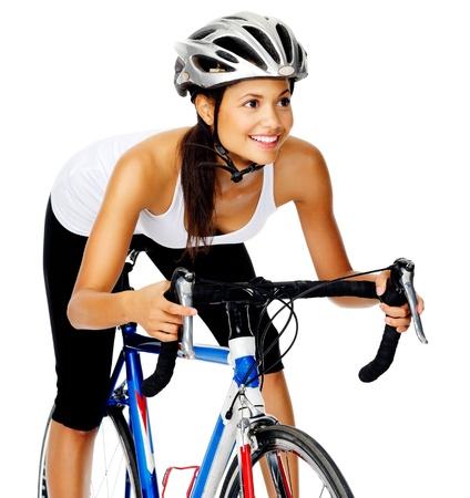 riding helmet: Ciclista feliz mujer hispana en una bicicleta de carretera en el estudio, aislado en blanco Foto de archivo