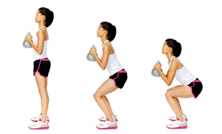Series of kettlebell weight exercise sequence to promote strength and muscle tone, please see portfolio for more in this series. Stock Photo - 13183275
