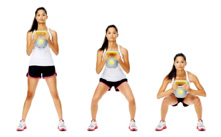 Series of kettlebell weight exercise sequence to promote strength and muscle tone, please see portfolio for more in this series. Stock Photo - 13183270