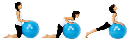 muscle toning: Fit healthy woman uses pilates gym ball as part of toning and muscle building training exercise. isolated on white, see portfolio for more in this series. Stock Photo