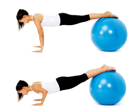 series: Fit healthy woman uses pilates gym ball as part of toning and muscle building training exercise. isolated on white, see portfolio for more in this series. Stock Photo