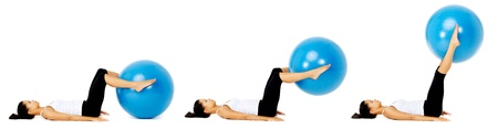 Fit healthy woman uses pilates gym ball as part of toning and muscle building training exercise. isolated on white, see portfolio for more in this series. photo