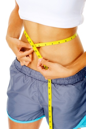 weightloss: Hispanic woman measuring the circumference of her waist, a weightloss concept Stock Photo