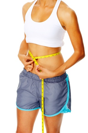 circumference: Hispanic woman measuring the circumference of her waist, a weightloss concept Stock Photo