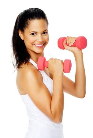 toning: Beautiful latino woman do toning exercises with dumbbells in studio Stock Photo
