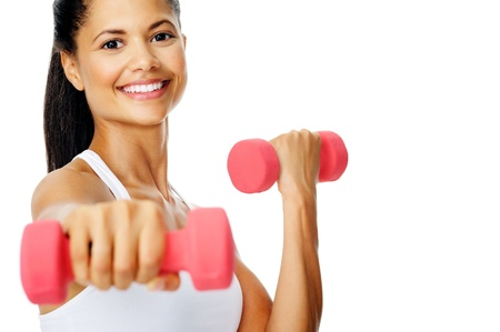 Beautiful latino woman does toning exercises with dumbbells in studio Stock Photo - 13183389