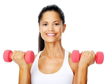 toning: Beautiful latino woman does toning exercises with dumbbells in studio