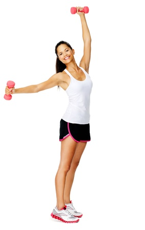 Healthy active mixed race female raises weights above her head for toning exercises isolated on white Stock Photo - 13183485
