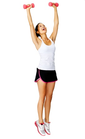 Healthy active hispanic woman raises weights above her head for toning exercises Stock Photo - 13183471