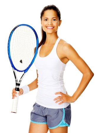 Healthy happy confident woman with a wristband poses with a tennis racket photo