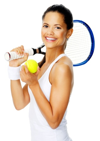 Healthy happy hispanic woman with a wristband poses with a tennis racket while holding tennis ball photo