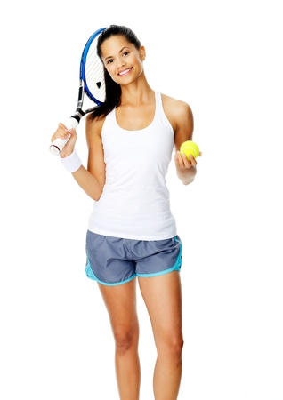 Healthy happy smiling hispanic woman with a wristband poses with a tennis racket and ball photo