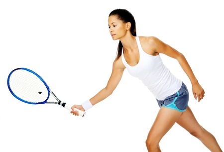 Slim fit asian woman holds out her tennis racket to return serve in a rally Stock Photo - 13183481