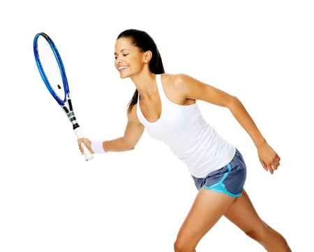 Happy asian woman holds out her tennis racket in forehand stroke to return a rally photo