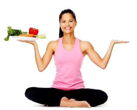 vitality: portrait of a young latino woman with fresh vegetables on a plate, healthy eating lifestyle Stock Photo