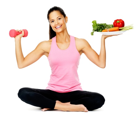 Portrait of a healthy woman with vegetables and dumbbells promoting a healthy fitness and eating lifestyle