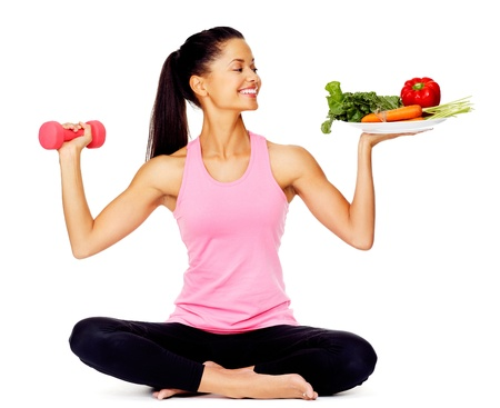 girl woman: Portrait of a healthy woman with vegetables and dumbbells promoting a healthy fitness and eating lifestyle