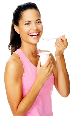 portrait of a friendly hispanic woman eating yoghurt promoting healthy lifestyle and dieting. Stock Photo - 13303201