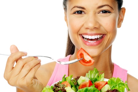 beautiful salad: Portrait of a fit healthy hispanic woman eating a fresh salad isolated on white