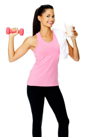 portrait of a beautiful hispanic girl with dumbbell and protien shake photo