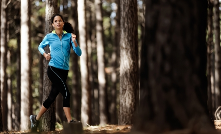 runner trail running training in forest outdoors, helathy fitness wellness athlete portrait photo