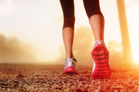 Athlete runner feet running on road closeup on shoe  woman fitness sunrise jog workout wellness concept Stock Photo - 14342123