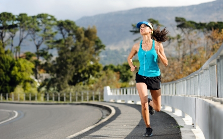 Endurance athlete training on sidewalk, running fitness marathon woman  exercise healthy lifestyle concept   photo