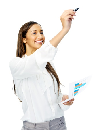 Businesswoman in long sleeved shirt holds up a felt tip marker pen to write in mid air, isolated on white photo
