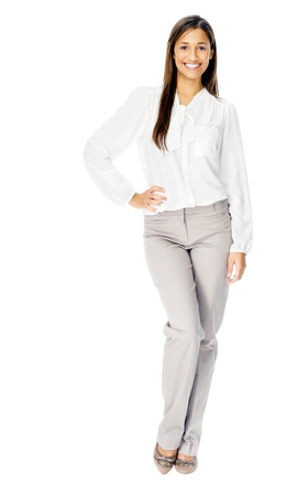long sleeved: Businesswoman confident portrait of a hispanic woman with arms crossed isolated on white background in studio.