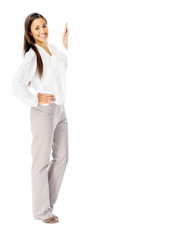 Portrit of a happy businesswoman with blank white board for advertising copyspace. isolated in studio photo