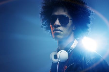 Confident dj portrait with club lights lens flare and retro man with afro and headphones Stock Photo - 14342367