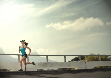 perseverance: Runner woman exercise outdoors panorama with copyspace in vintage tone