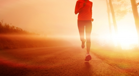 marathon: Athlete running on the road in morning sunrise training for marathon and fitness. Healthy active lifestyle latino woman exercising outdoors.
