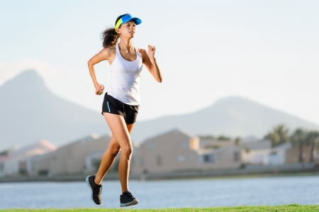 Healthy active female runner training outdoors for marathon. fitness woman lifestyle photo